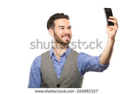 Young man taking selfie picture with smart-phone