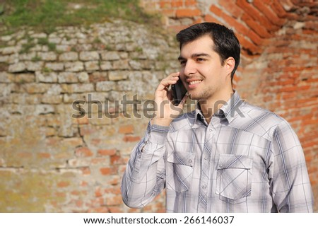 Young man talking on a smart phone