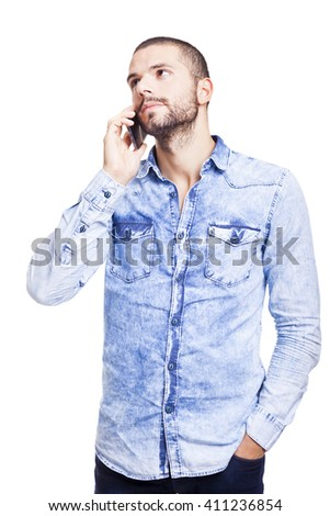 Young man talking on mobile phone, isolated on white background - stock photo