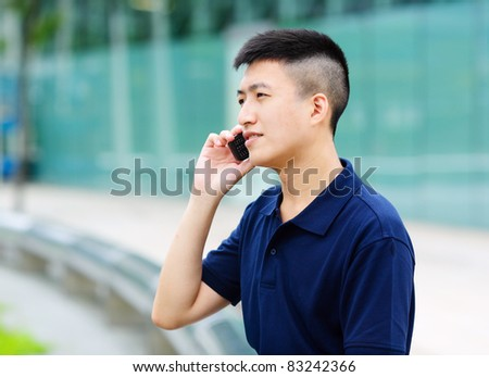 young man talking on phone - stock photo