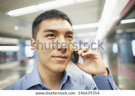 Young man talking on the phone, portrait - stock photo
