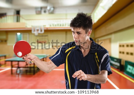 young man tennis-player in play on chroma key - stock photo