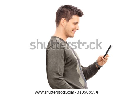 Young man texting on his cell phone isolated on white background