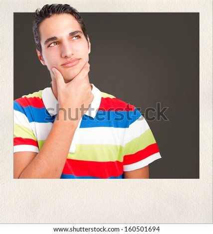 young man thinking - stock photo