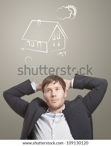 Young man thinking about his dream house - stock photo