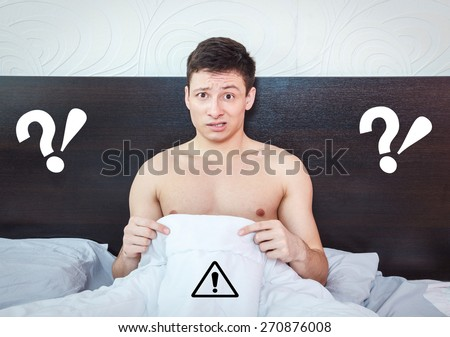 Young man thinking about impotency problems and wondering about prostate trouble , Rejected man feeling shame of his erection failure - stock photo