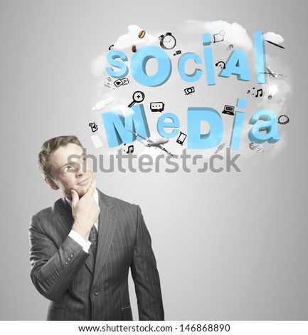 young man thinking about social media - stock photo