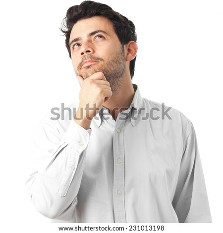 young man thinking on a white background - stock photo