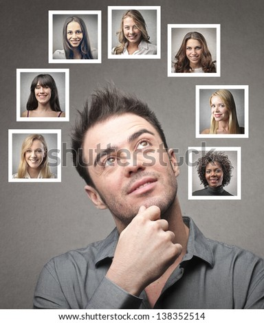 young man thinks his lovers - stock photo
