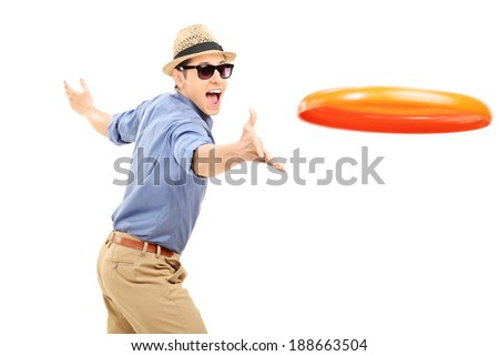 Young man throwing a frisbee disk isolated on white background - stock photo