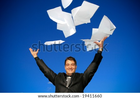 Young man throws away his documents. - stock photo