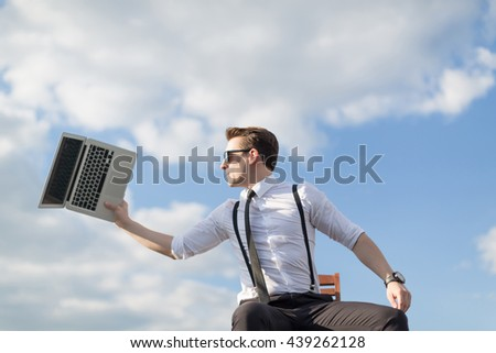 young man throws notebook - stock photo