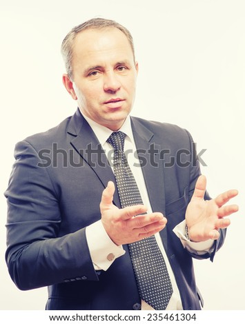 Young man throws up his hands in surprise - stock photo