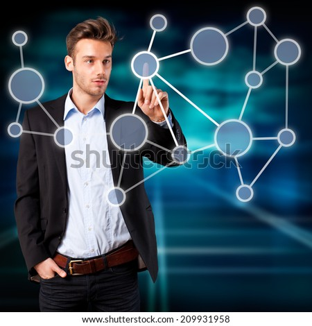 young man touching a node in a network