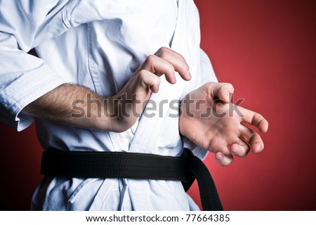Young man training karate, sport and fitness at gym - stock photo