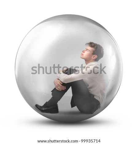 Young man trapped in a bubble - stock photo