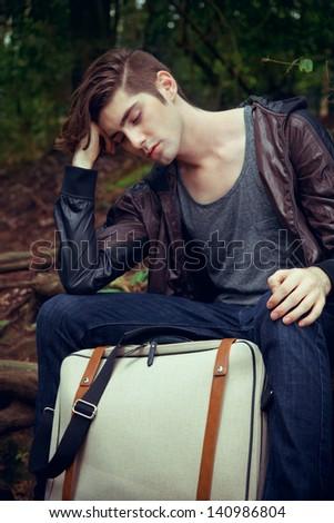 Young man travel around Japan - stock photo