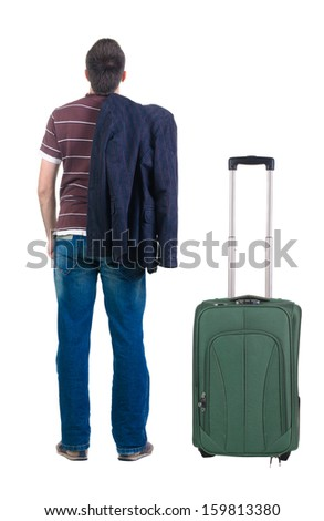 young man traveling with suitcas  looks ahead. rear view. Isolated over white . - stock photo