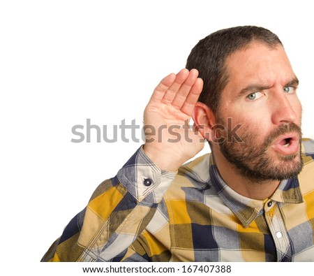 young man trying to listen - stock photo