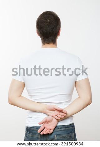 Young man turning back, white background - stock photo