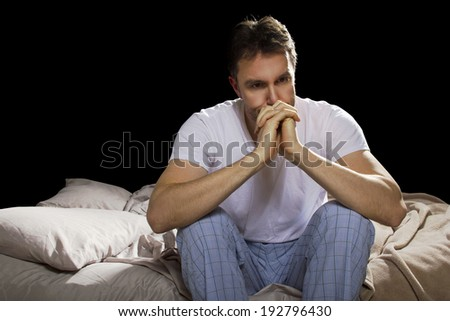 young man unable sleep because of stress of problems - stock photo