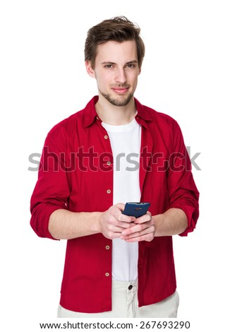 Young man use his mobile phone