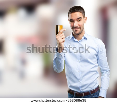 Young man using a credit card - stock photo
