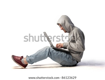 Young man using a laptop - stock photo