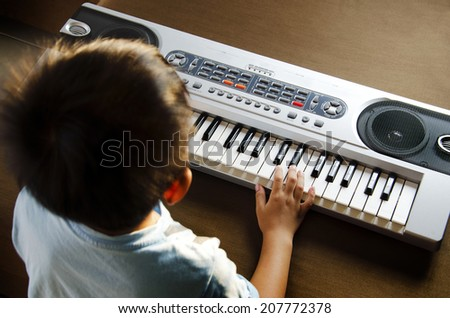 Young man using hands to play the Electone. - stock photo