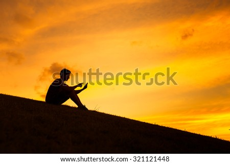Young man using his smart phone. - stock photo