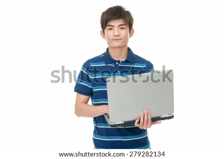 young man using laptop computer, standing, - stock photo