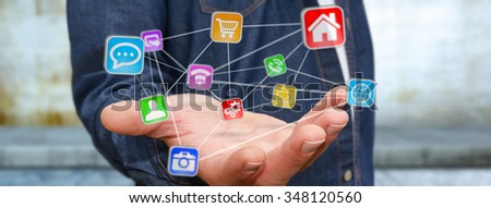 Young man using modern application with his hand - stock photo