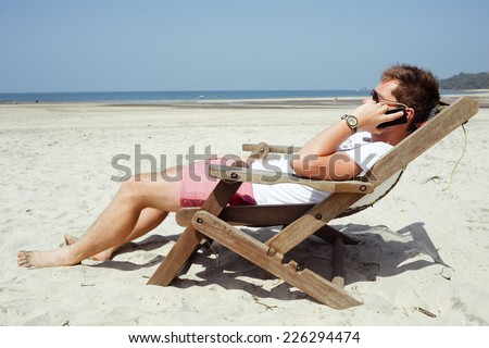 Young man using the smart phone - stock photo