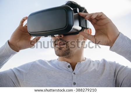 Young Man Using Virtual Glasses - stock photo