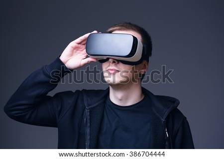 Young man using Virtual Reality glasses