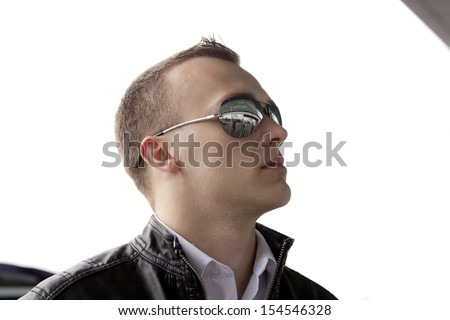 Young man waiting on a plane. Reflection in sunglasses - stock photo