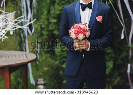 young man waiting woman.Groom waiting bride.Just married. Close up. Bridal wedding bouquet of flowers