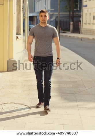 Young man walking at the street
