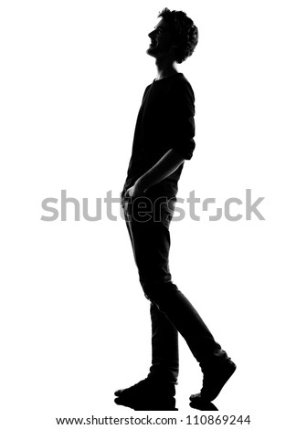young man  walking  happy laughing silhouette in studio isolated on white background