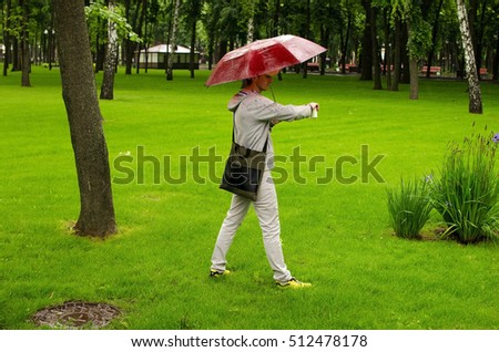 Young man walking in the city during the rain