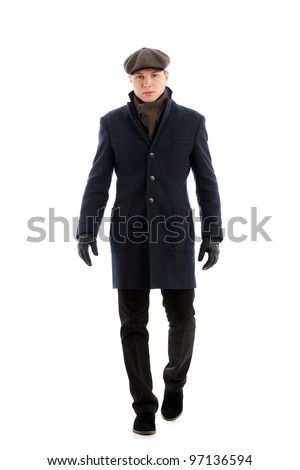 Young man walking. Isolated over white.