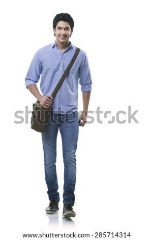 Young man walking over white background - stock photo