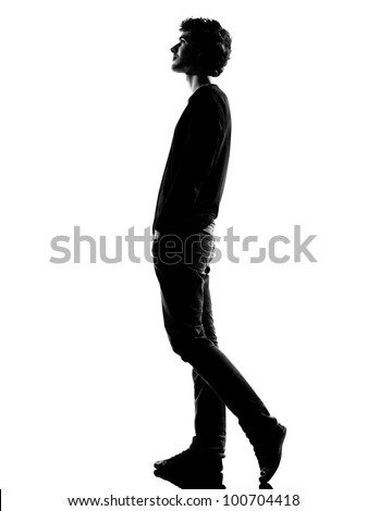 young man  walking silhouette in studio isolated on white background - stock photo