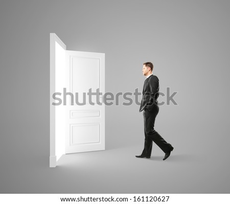 young man walking to opened door