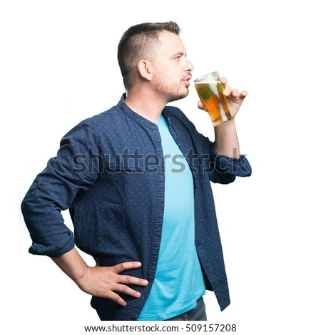 Young man wearing a blue outfit. Drinking beer.
