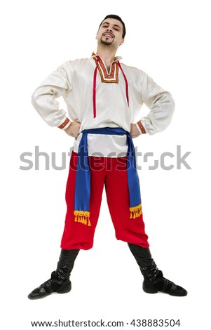 young man wearing a folk costume posing against isolated white with copyspace