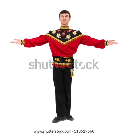 young man wearing a folk russian costume posing against isolated white background - stock photo