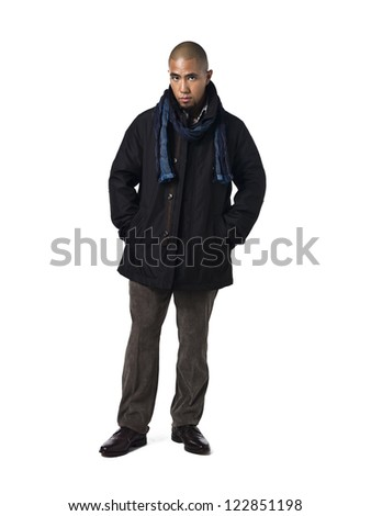 Young man wearing a scarf and a jacket against white background - stock photo