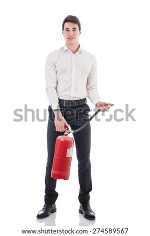 Young Man Wearing Business Wear Standing in Studio Holding Fire Extinguisher and Looking at Camera