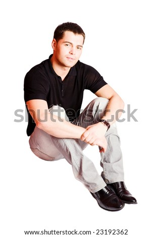 Young man wearing casual closes sitting isolated on white - stock photo
